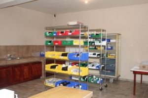 Shelves in the new pharmacy with bins for medications
